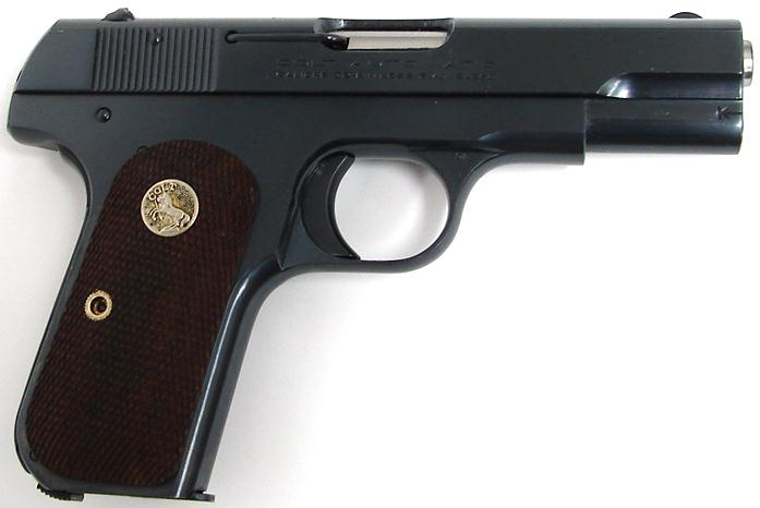 Colt Model 1903 Pocket Hammerless Third Variant walnut grips with a Colt medallion