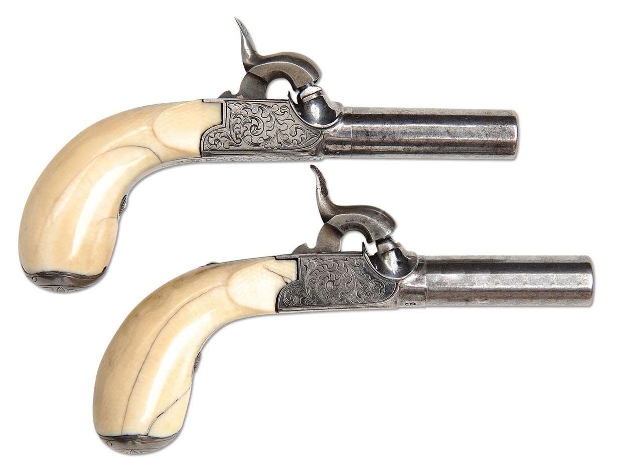Percussion muff pistols